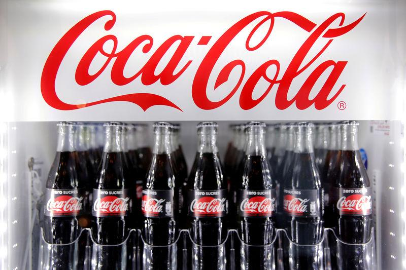 FILE PHOTO: FILE PHOTO: Bottles of Coca-Cola are pictured in a cooler during a news conference in Paris