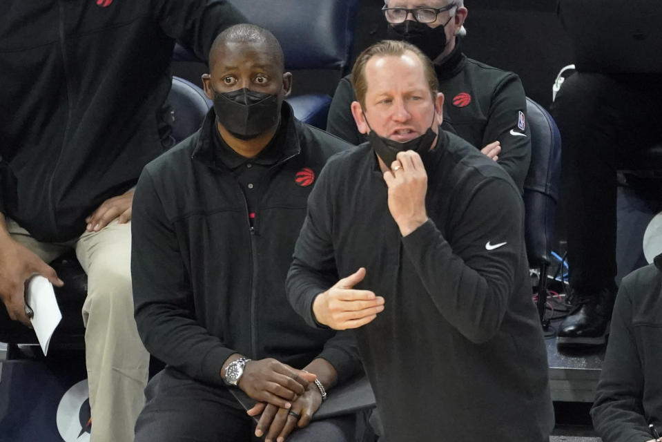 Toronto Raptors coach Nick Nurse talks to players during the second half of an NBA basketball game against the Minnesota Timberwolves, Friday, Feb. 19, 2021, in Minneapolis. (AP Photo/Jim Mone)