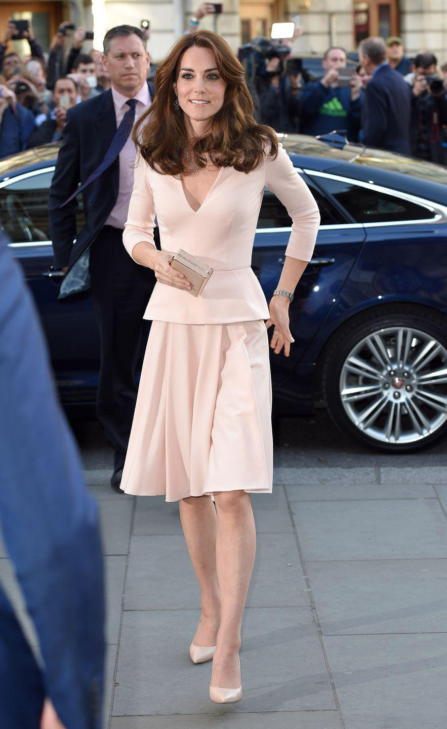 <p>The Duchess went for a blush Alexander McQueen peplum set, paired with nude pumps while arriving at the the National Portrait Gallery in London, England. </p>