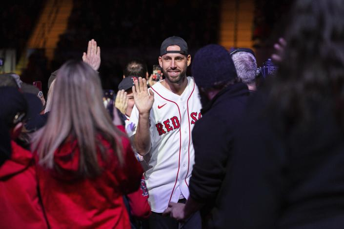 Boston Red Sox relief pitcher Matt Barnes greets fans on his way to the stage during the baseball team's fan fest Friday, Jan. 17, 2020, in Springfield, Mass. (Leon Nguyen/The Republican via AP)