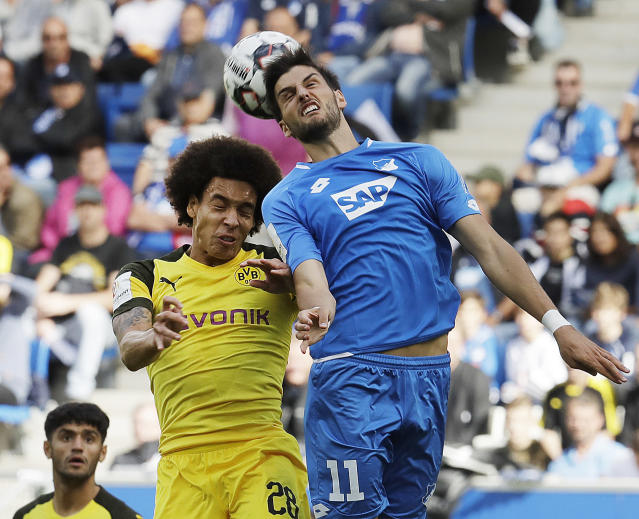 Hoffenheim's Florian Grillitsch, right, and Dortmund's Axel Witsel challenge for the ball during a German Bundesliga soccer match between TSG 1899 Hoffenheim and Borussia Dortmund in Sinsheim, Germany, Saturday, Sept. 22, 2018. (AP Photo/Michael Probst)