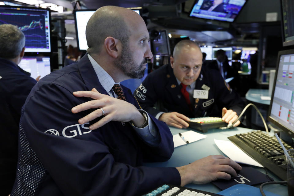 Specialists James Denaro, left, and Mario Picone work at a post on the floor of the New York Stock Exchange, Tuesday, March 12, 2019. Another slide in Boeing weighed on the Dow Jones Industrial Average. (AP Photo/Richard Drew)