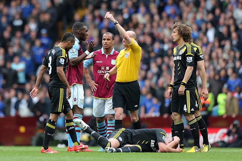 Aston Villa's Christian Benteke, second left, is shown a red card by referee Lee Mason after a challenge on Chelsea's John Terry, on the ground, during the English Premier League soccer match at Villa Park, Birmingham, England, Saturday May 11, 2013. Chelsea won the match 1-2. (AP Photo/PA, Nick Potts) UNITED KINGDOM OUT NO SALES NO ARCHIVE