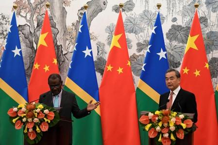 Solomon Islands Foreign Minister Jeremiah Manele and Chinese State Councilor and Foreign Minister Wang Yi hold joint news conference at the Diaoyutai State Guesthouse in Beijing