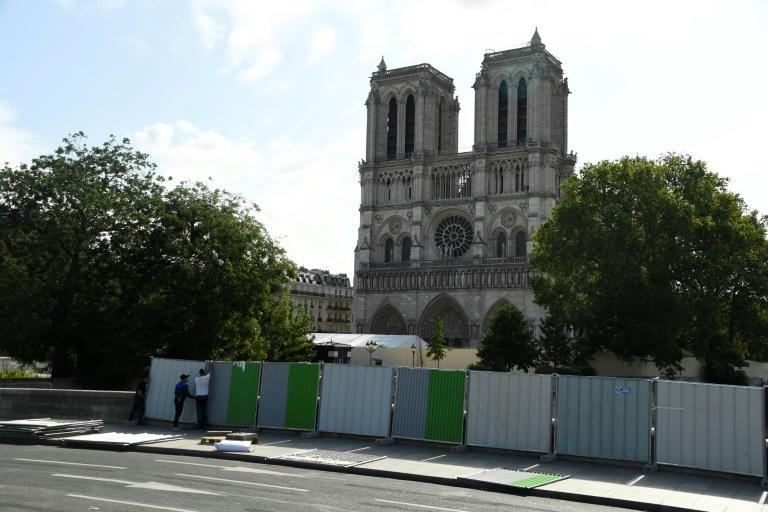 Workers installed fencing around Notre-Dame Cathedral in August as they began lead clean-up operations