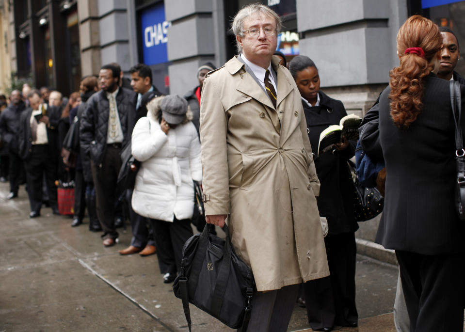 Eric Lipps, 52, waits in line to enter the NYCHires Job Fair in New York December 9, 2009. While the jobless rate has edged down, high unemployment rate remains a political headache for President Barack Obama and fellow Democrats, who are worried they will lose seats in Congress in next November's elections if faster recovery is not faster. REUTERS/Shannon Stapleton (UNITED STATES BUSINESS EMPLOYMENT POLITICS IMAGES OF THE DAY)