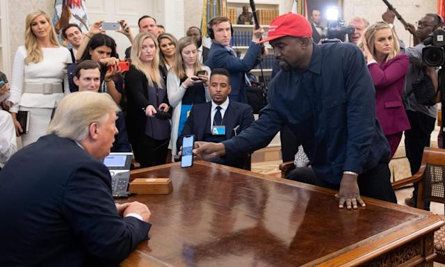 "<span class=""element-image__caption"">Donald Trump meets with rapper Kanye West at the White House in 2018.</span> <span class=""element-image__credit"">Photograph: Saul Loeb/AFP/Getty Images</span>"