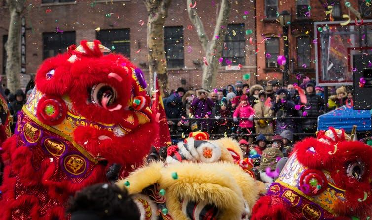 Crowds watching a lion dance during Lunar New Year.