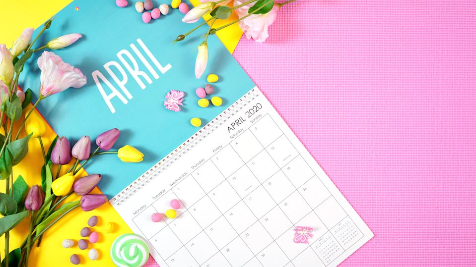 On-trend 2020 calendar page for the month of April modern flat lay with seasonal food, candy and colorful decorations in popular pastel colors. Copy space. One of a series for 12 months of the year.