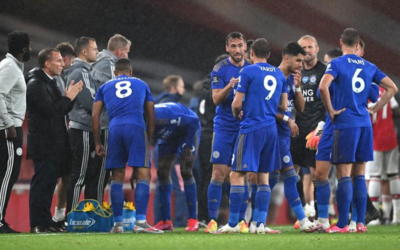Brendan Rodgers, manager of Leicester City, gives his team instructions during a drinks break  - GETTY IMAGES