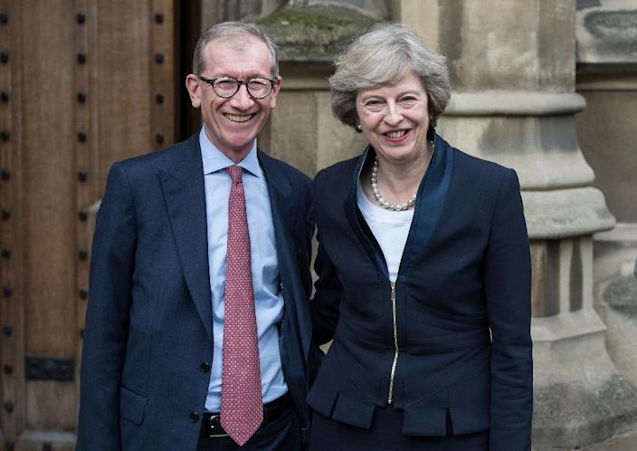 Britain's new Conservative Party leader Theresa May (R) poses for a photograph with her husband Philip John May on July 11, 2016 (AFP Photo/Chris Ratcliffe)