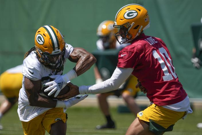 Green Bay Packers' Jordan Love hands off to Aaron Jones during an NFL football minicamp Tuesday, June 8, 2021, in Green Bay, Wis. (AP Photo/Morry Gash)