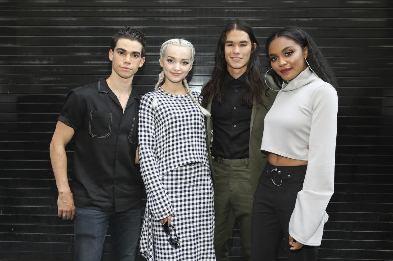 "IMAGE DISTRIBUTED FOR DISNEY ABC - Actor Cameron Boyce, Dove Cameron, Booboo Stewart, and China Anne McClain seen outside of the Disney Channel's ""Descendants 2"" panel event at the Soho Apple Store on Monday, July 17, 2017 in New York. (Mark Von Holden/AP Images for Disney ABC)"