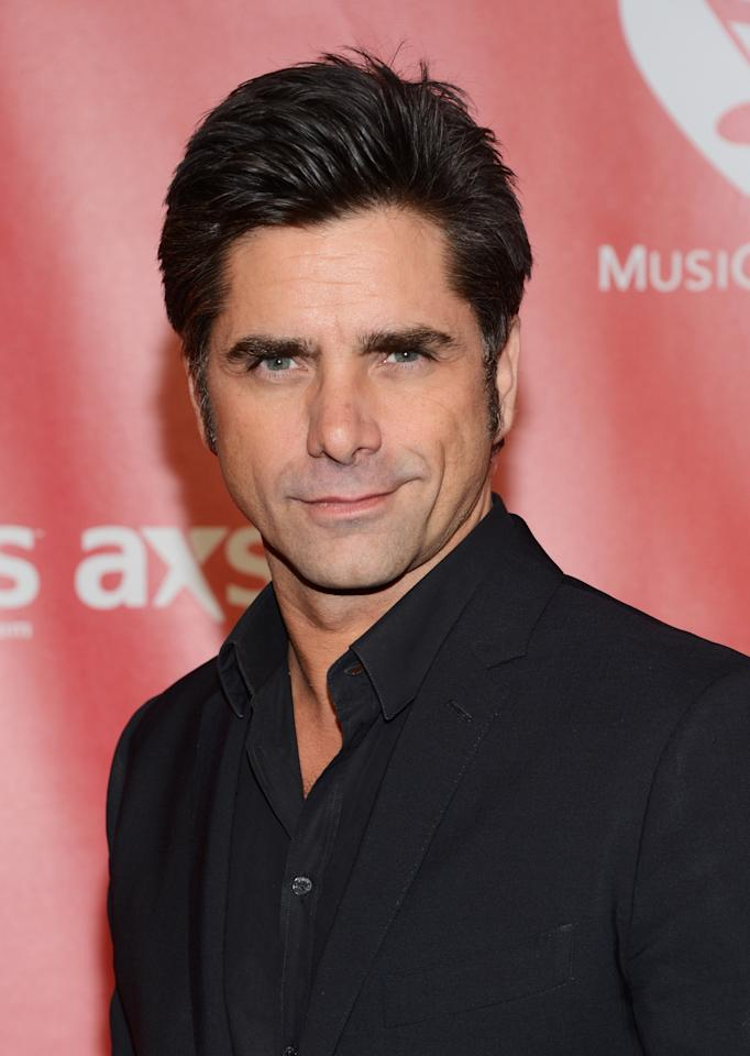 LOS ANGELES, CA - FEBRUARY 08:  Actor John Stamos arrives at he 2013 MusiCares Person Of The Year Gala Honoring Bruce Springsteen at Los Angeles Convention Center on February 8, 2013 in Los Angeles, California.  (Photo by Jason Kempin/Getty Images)