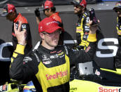 Sebastien Bourdais (18) celebrates after winning the IndyCar Firestone Grand Prix of St. Petersburg Sunday, March 11, 2018, in St. Petersburg, Fla. (AP Photo/Jason Behnken)