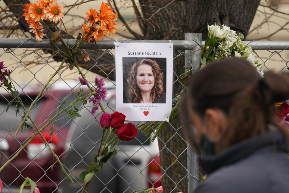 A photograph of Suzanne Fountain, one of the victims of a mass shooting at a King Soopers grocery store, hangs on the temporary fence around the store Wednesday, March 24, 2021, in Boulder, Colo. (AP Photo/David Zalubowski)