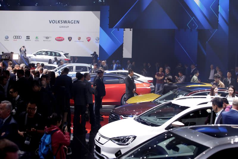 FILE PHOTO: New cars are displayed at a Volkswagen event in Beijing
