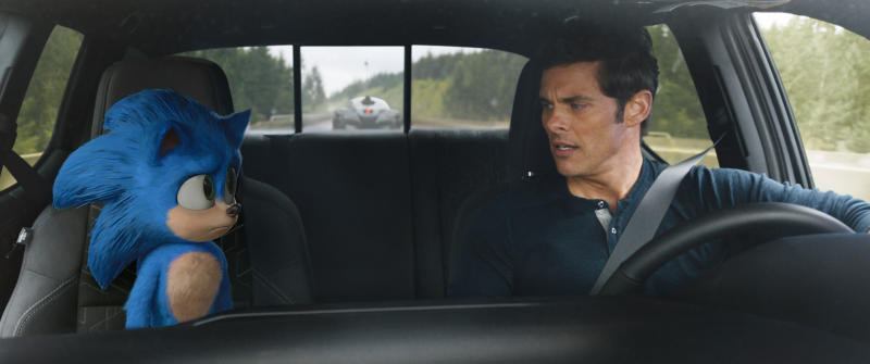 """This image released by Paramount Pictures shows Sonic, voiced by Ben Schwartz, left, and James Marsden in a scene from """"Sonic the Hedgehog ."""" (Paramount Pictures/Sega of America via AP)"""