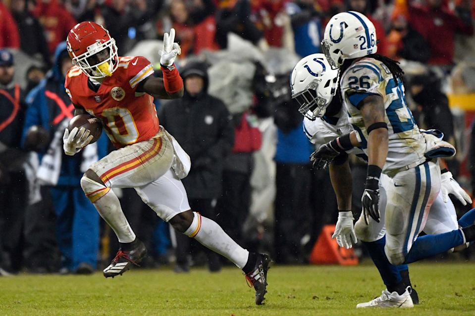Kansas City Chiefs wide receiver Tyreek Hill (10) gestures as he runs past Indianapolis Colts safety Clayton Geathers (26) and linebacker Anthony Walker during the second half of an NFL divisional football playoff game in Kansas City, Mo., Saturday, Jan. 12, 2019. (AP Photo/Ed Zurga)