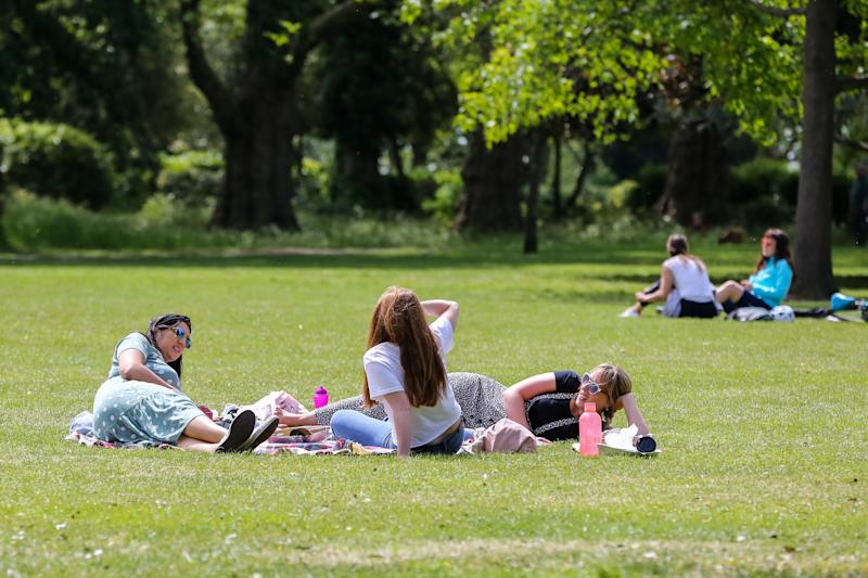 People enjoying the warm weather in Finsbury park during the COVID-19 lockdown. The government has relaxed the restrictions on coronavirus lockdown to allowing people to spend more time outside. (Photo by Steve Taylor / SOPA Images/Sipa USA)