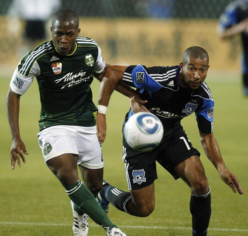 Portland Timbers' Darlington Nagbe, left, and San Jose Earthquakes' Justin Morrow (15) go after a ball in the first half during an MLS soccer game Wednesday, Sept. 21, 2011, in Portland, Ore.  (AP Photo/Rick Bowmer)