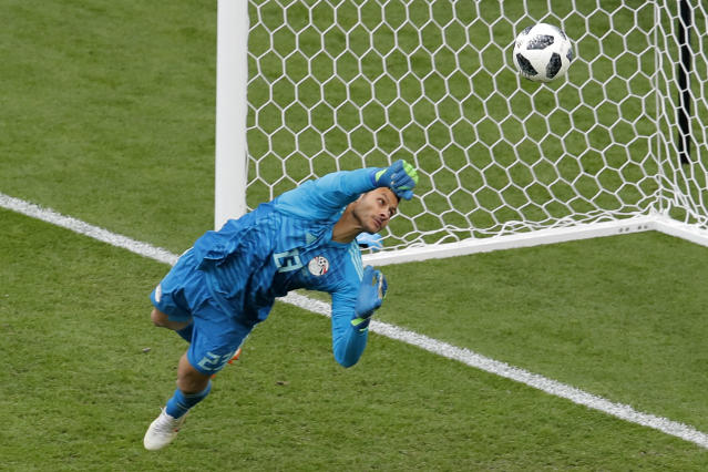 Egypt goalkeeper Mohamed Elshenawy clears the ball during the group A match between Egypt and Uruguay at the 2018 soccer World Cup in the Yekaterinburg Arena in Yekaterinburg, Russia, Friday, June 15, 2018. (AP Photo/Vadim Ghirda)
