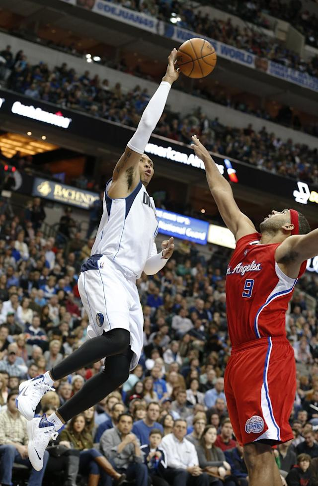Dallas Mavericks forward Shawn Marion (0) take a shot over Los Angeles Clippers forward Jared Dudley (9) during the second half of an NBA basketball game Friday, Jan. 3, 2014, in Dallas. The Clippers won 119-112. (AP Photo/Sharon Ellman)