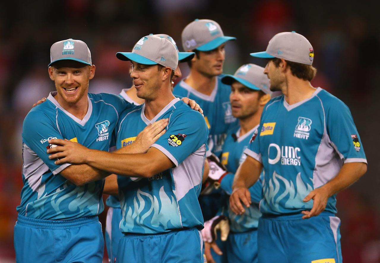 MELBOURNE, AUSTRALIA - JANUARY 15:  The Heat celebrate after defeating the Renegades during the Big Bash League Semi-Final match between the Melbourne Renegades and the Brisbane Heat at Etihad Stadium on January 15, 2013 in Melbourne, Australia.  (Photo by Robert Cianflone/Getty Images)