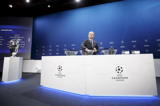 UEFA deputy secretary general Giorgio Marchetti removes the balls containing the names of the soccer clubs at the UEFA headquarters in Nyon, Switzerland, Monday, July 22, 2019 during the drawing of the matches for the Champions League 2019/20 third qualifying round. (Salvatore Di Nolfi/Keystone via AP)