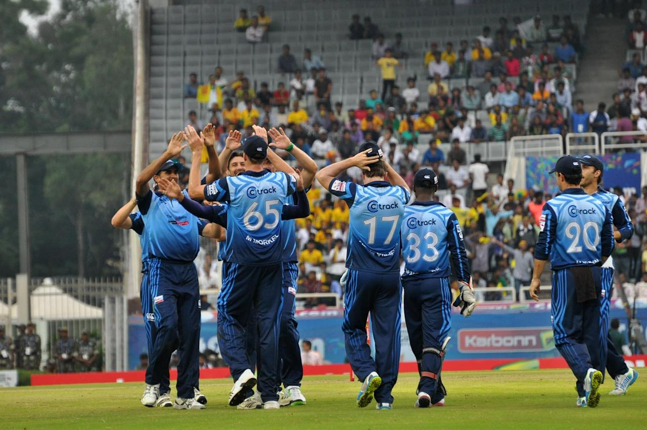 Players of Titans celebrates after taking wicket during match against Sunrisers Hyderabad at Karbonn Smart Champions League Twenty-20 Match at Jharkhand State Cricket Association (JSCA) International Cricket Stadium in Ranchi on 28 Sept. 2013. (Photo: IANS)