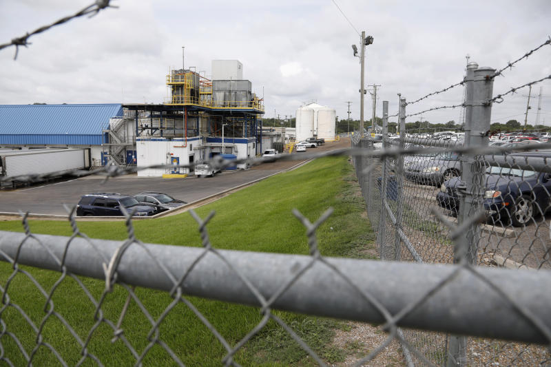 Business continues at this Koch Foods Inc., plant in Morton, Miss., Thursday, Aug. 8, 2019, following Wednesday's raid by U.S. immigration officials. In an email Thursday, U.S. Immigration and Customs Enforcement spokesman Bryan Cox said more than 300 of the 680 people arrested Wednesday have been released from custody. (AP Photo/Rogelio V. Solis)