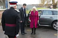 <p>The Duchess of Cornwall arrived at her royal patronage, the National Literacy Trust, wearing a magenta coat over a paisley print dress with black boots and a black handbag. Camilla accessorized the look with a pearl choker, pearl drop earrings, and a brooch. </p>