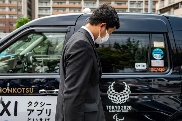 Many taxis in Tokyo carry the logo of the Olympic and Paralympic Games