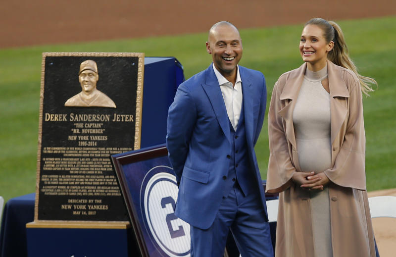 NEW YORK, NY - MAY 14: Former New York Yankees great, Derek Jeter and his wife Hannah pose in front of his plaque during a pregame ceremony honoring Jeter and retiring his number 2 at Yankee Stadium on May 14, 2017 in New York City. (Photo by Rich Schultz/Getty Images)