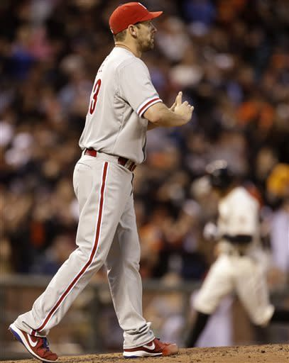 Philadelphia Phillies' Cliff Lee, left, walks back to the mound after giving up a home run to San Francisco Giants' Hunter Pence, right, in the second inning of a baseball game Monday, May 6, 2013, in San Francisco. (AP Photo/Ben Margot)