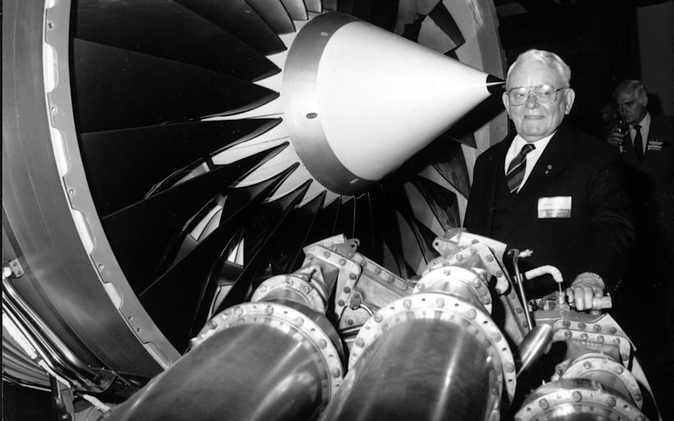 Sir Frank Whittle, inventor of the jet engine, with a Rolls-Royce RB211 engine - PA