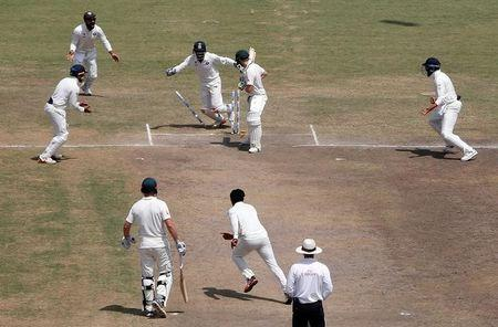 Cricket - India v Australia - Third Test cricket match - Jharkhand State Cricket Association Stadium, Ranchi, India - 20/03/17 - Australia's captain Steven Smith is clean bowled as Indian players celebrate. REUTERS/Adnan Abidi