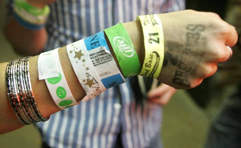 In this April 3, 2010, photo a bar patron shows the wrist bands she collected while visiting various establishments in downtown Iowa City, Iowa. The Princeton Review named the University of Iowa as the nations's best party school Monday, Aug. 5, 2013, on a list determined by 126,000 students in a nationwide survey. (AP Photo/Iowa City Press Citizen, Dan Williamson)