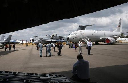 U.S. Air Force Boeing P-8 Poseidon (R) is displayed at the Singapore Airshow at Changi Exhibition Center February 18, 2016. REUTERS/Edgar Su