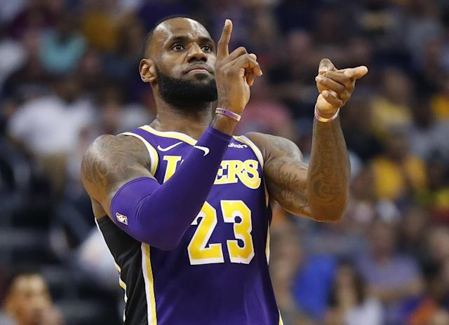 """Lakers star LeBron James would have plenty of reason to celebrate if the team came back to win an NBA title this season. <span class=""""copyright"""">(Matt York / Associated Press)</span>"""
