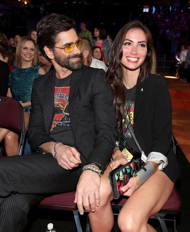<p>Stamos, who began dating McHugh in 2015, couldn't take his eyes off her at the 2017 Kids' Choice Awards. (Photo: Chris Polk/KCA2017/Getty Images for Nickelodeon) </p>