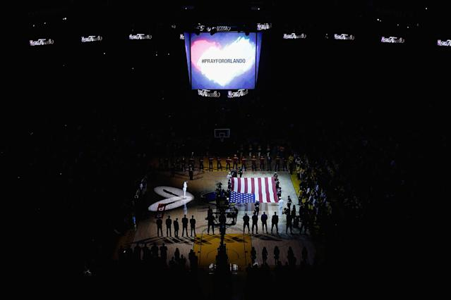 <p>A moment of silence is observed for victims of the Orlando nightclub mass shooting prior to Game 5 of the 2016 NBA Finals between the Cleveland Cavaliers and the Golden State Warriors at Oracle Arena on June 13, 2016 in Oakland, Calif. (Photo: Ezra Shaw/Getty Images) </p>