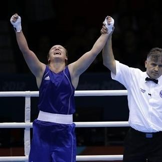 Kazakhstan's Marina Volnova celebrates, left, after defeating Britain's Savannah Marshall, right, in a women's middleweight 75-kg quarterfinal boxing match at the 2012 Summer Olympics, Monday, Aug. 6, 2012, in London. (AP Photo/Mike Groll)