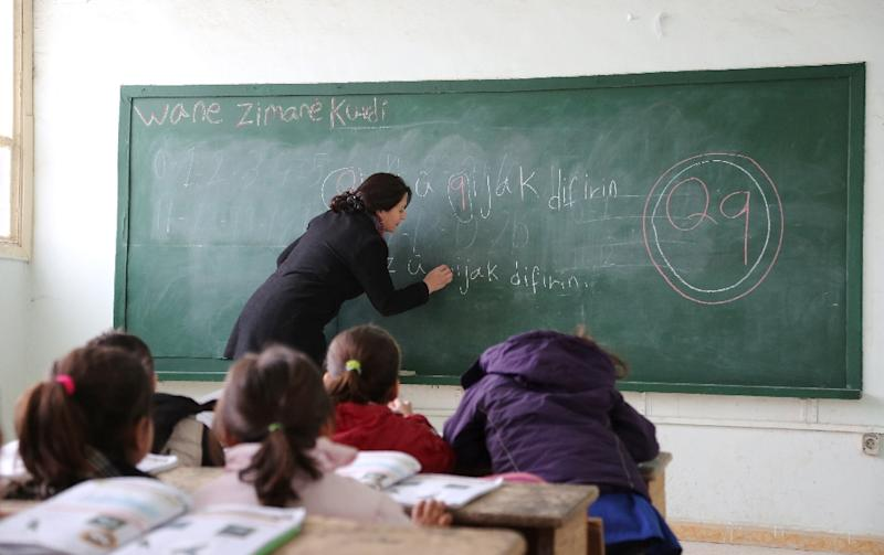 A Kurdish teacher takes a class at the Musa Bin Nusayr school in the northeastern Syrian city of Qamishli (AFP Photo/Delil Souleiman)