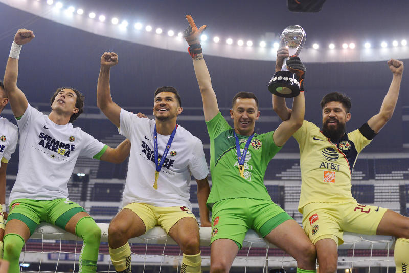 "MEXICO CITY, MEXICO - DECEMBER 16: (L-R) Oscar Jimenez, Henry Martin, Agustin Marchesin and Oribe Peralta of America celebrate the championship holding the cup during the final second leg match between Cruz Azul and America as part of the Torneo Apertura 2018 Liga MX at Azteca Stadium on December 16, 2018 in Mexico City, Mexico. (Photo by Jaime Lopez/Jam Media/Getty Images)""n"