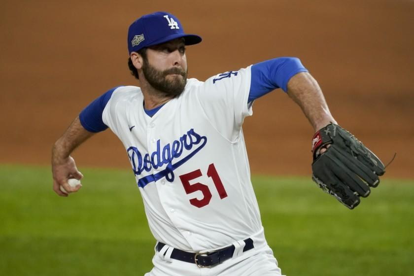 Los Angeles Dodgers relief pitcher Dylan Floro throws against the Atlanta Braves during the fifth inning in Game 2 of a baseball National League Championship Series Tuesday, Oct. 13, 2020, in Arlington, Texas. (AP Photo/Tony Gutierrez)
