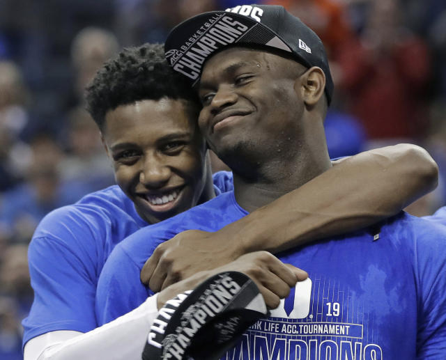 FILE - In this March 16, 2019, file photo, Duke's RJ Barrett, left, hugs Zion Williamson after Duke defeated Florida State in the NCAA college basketball championship game of the Atlantic Coast Conference tournament, in Charlotte, N.C. Duke's Zion Williamson and R.J. Barrett are the second freshman teammates to earn first-team All-America honors. Williamson and Barrett headed The Associated Press All-America team released on Tuesday, April 2, 2019, joined by Tennessee's Grant Williams, Murray State's Ja Morant and Cassius Winston of Michigan State. (AP Photo/Nell Redmond, File)