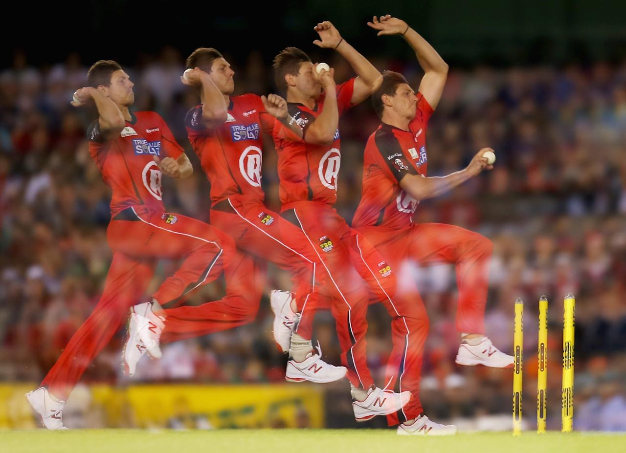 MELBOURNE, AUSTRALIA - DECEMBER 30: (EDITORS NOTE: this image was created using multiple exposure) James Pattinson of the Renegades bowls during the Big Bash League match between the Melbourne Renegades and Brisbane Heat at Etihad Stadium on December 30, 2013 in Melbourne, Australia. (Photo by Scott Barbour/Getty Images)