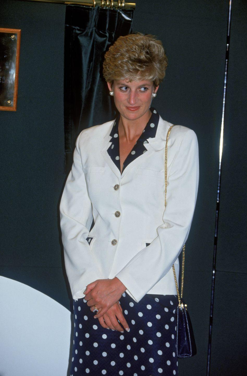 <p>While in Cardiff in June 1993, Diana opted for a foolproof outfit combination: a patterned navy and white dress paired with a white blazer.<br></p>