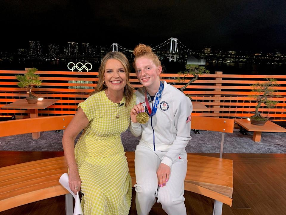 Savannah Guthrie poses beside swimmer Lydia Jacoby, who holds her gold medal up for the camera.